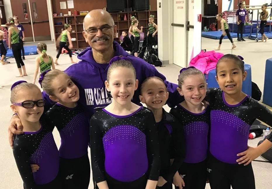 Plano Aerobats head coach Carlos Perez, shown here with several of his students, has retired after more than 30 years of service with the popular city program.