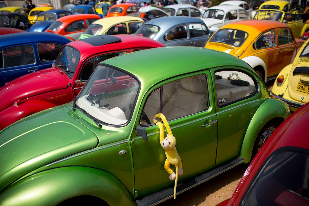 """FILE- In this April 21, 2017, file photo Volkswagen Beetles displayed during the annual gathering of the """"Beetle club"""" in Yakum, central Israel. Volkswagen says it will stop making its iconic Beetle in July of next year. Volkswagen of America on Thursday, Sept. 13, 2018, announced the end of production of the third-generation Beetle by introducing two final special editions. (AP Photo/Oded Balilty, File)"""