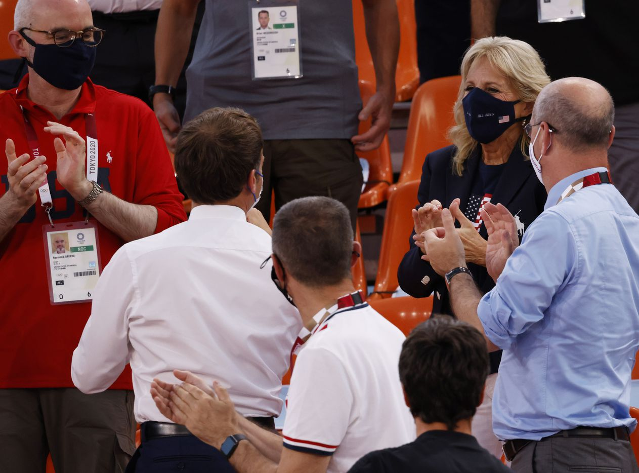 First lady Jill Biden and French President Emmanuel Macron talk after USA defeated France 17-10 in a 3x3 women's basketball game during the postponed 2020 Tokyo Olympics at Aomi Urban Sports Park on Saturday, July 24, 2021, in Tokyo, Japan. (Vernon Bryant/The Dallas Morning News)
