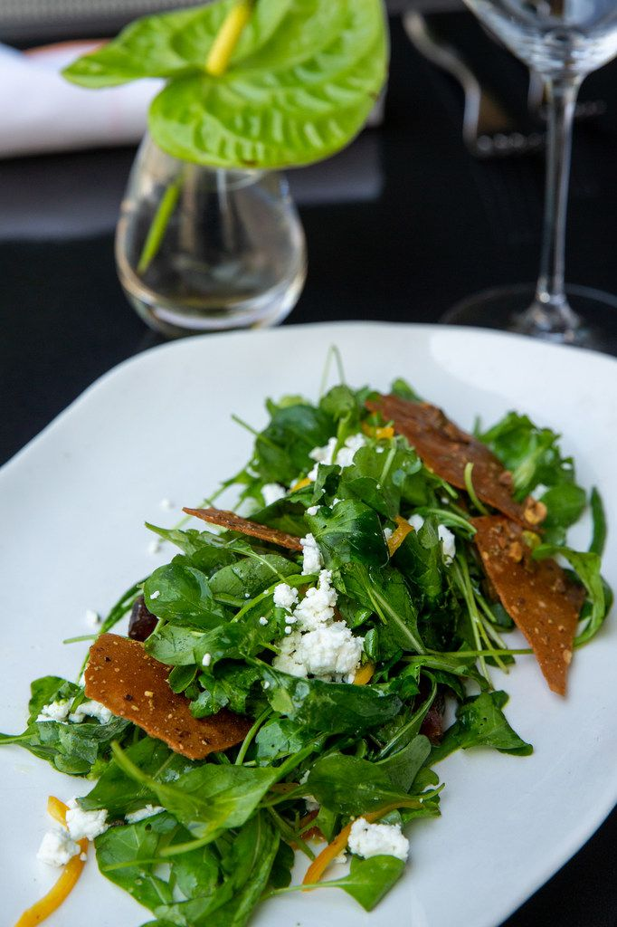 Arugula salad with preserved Meyer lemon, marinated dates and pistachio tuile