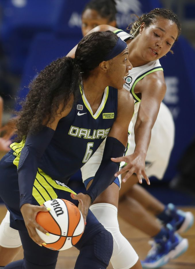Dallas Wings forward Kayla Thornton (6) looks to pass as she is defended by Minnesota Lynx forward Napheesa Collier (24) during first half action. The two teams played their WNBA game at College Park Center on the campus of the University of Arlington on June 17, 2021(Steve Hamm/ Special Contributor)