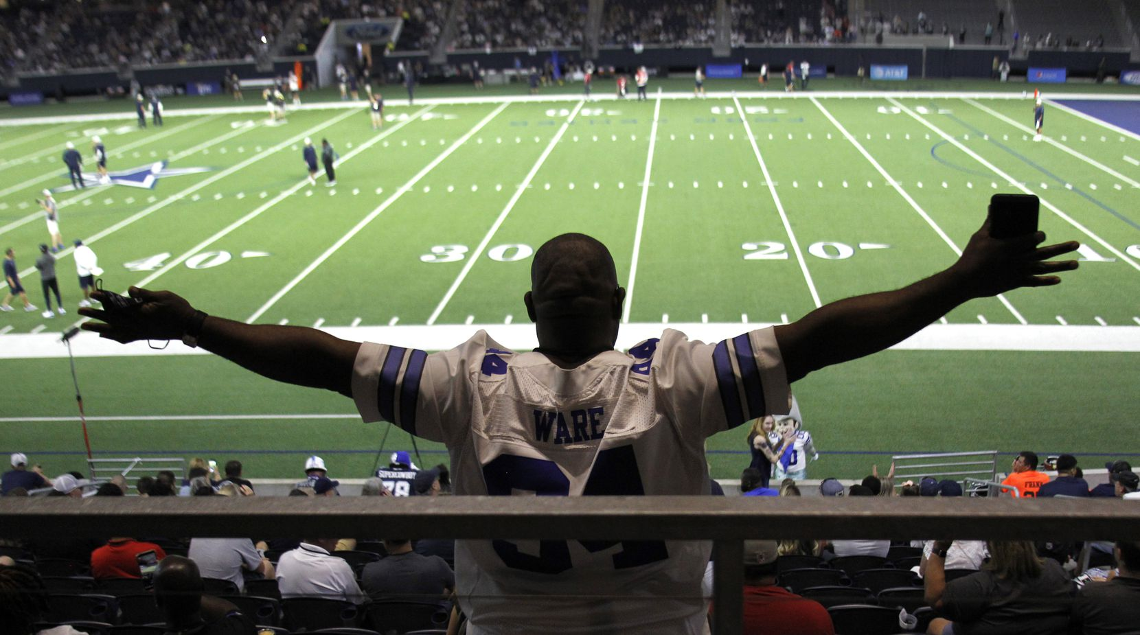 Dallas Cowboys fan Darrell Glenn takes in the team's final public practice of training camp. The Cowboys conducted the football practice session inside The Star at the Ford Center in Frisco on August 28, 2021. (Steve Hamm/ Special Contributor)