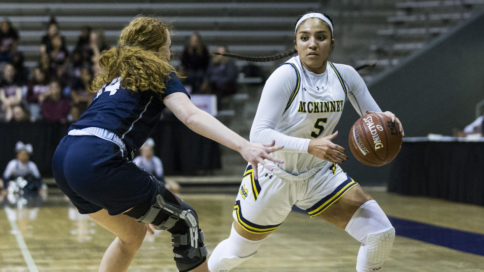 McKinney guard Trinity White (5) gets around Pflugerville Hendrickson's Sarah Malinowski during a Class 6A Region II semifinal on Feb. 28, 2020 at Ellis Davis Field House in Dallas.