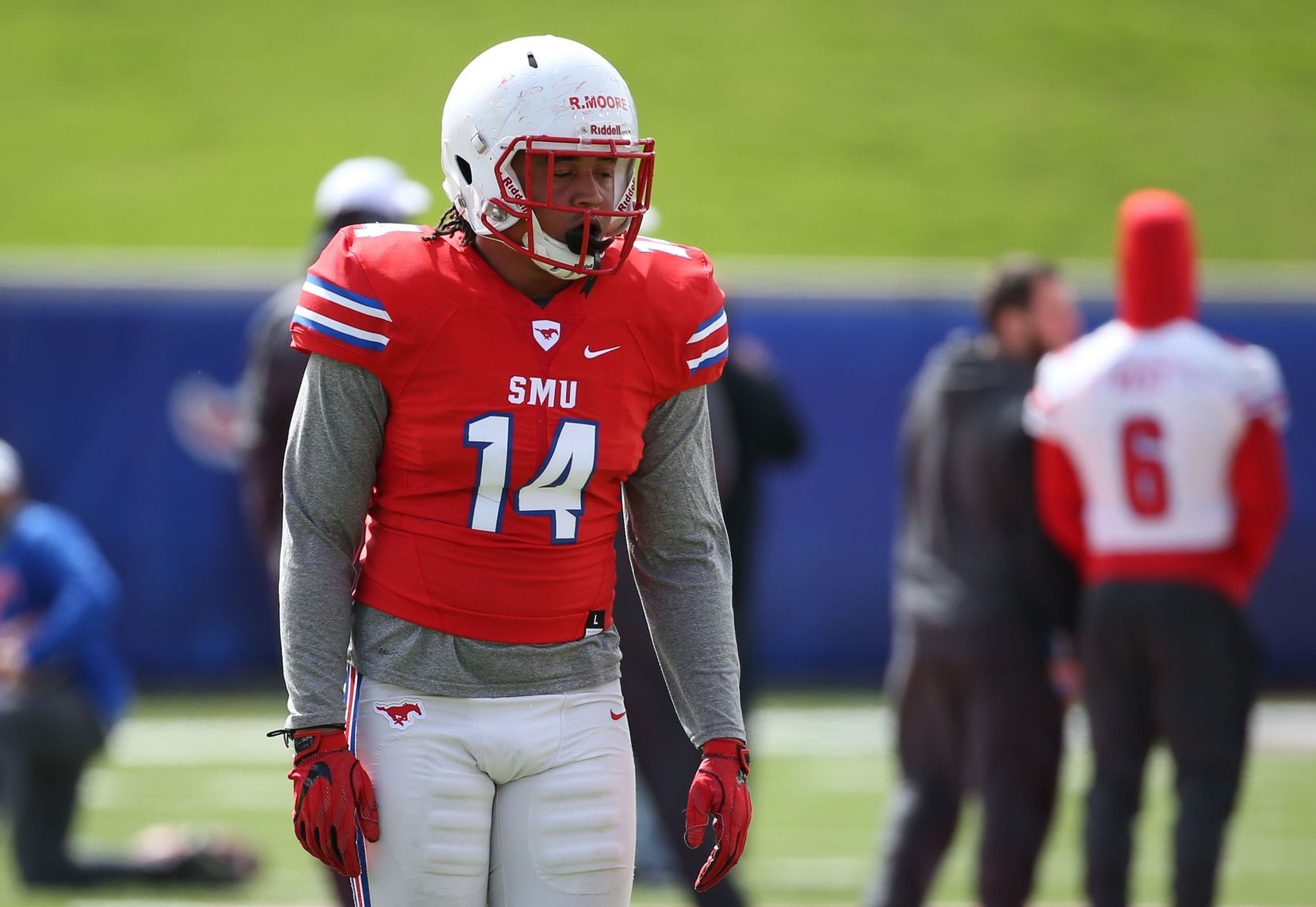 Southern Methodist Mustangs linebacker Richard Moore (14) walks on the field before Southern Methodist Mustangs's spring game at Gerald J. Ford Stadium on Saturday, April 14, 2018.