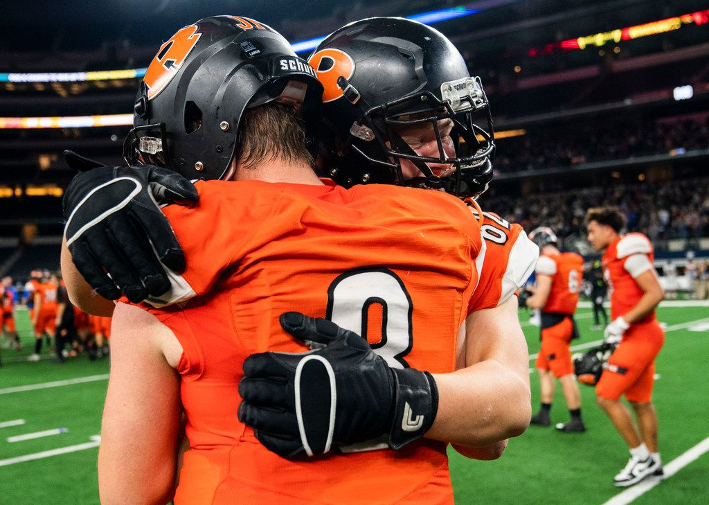 Rockwall quarterback Braedyn Locke (8) gets a hug from offensive lineman Caden Brown (62) after a 60-59 win over Allen in a Class 6A Division I area-round high school football playoff game between Allen and Rockwall on Friday, November 22, 2019 at AT&T Stadium in Arlington. (Ashley Landis/The Dallas Morning News)