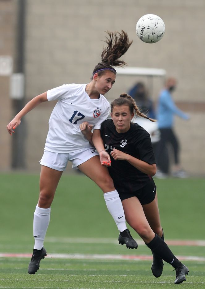 Wakeland's Lillian Wallace (17) and Dripping Springs' Chloe Fredenburg (22) go up  for the ball during their UIL 5A girls State championship soccer game at Birkelbach Field on April 16, 2021 in Georgetown, Texas. Dripping Springs won 2-1.  (Thao Nguyen/Special Contributor)
