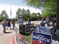 Candidates and their supporters held signs and passed out brochures at the Maribelle M. Davis Public Library in Plano Monday, the first day of early voting in the May 1 municipal election.