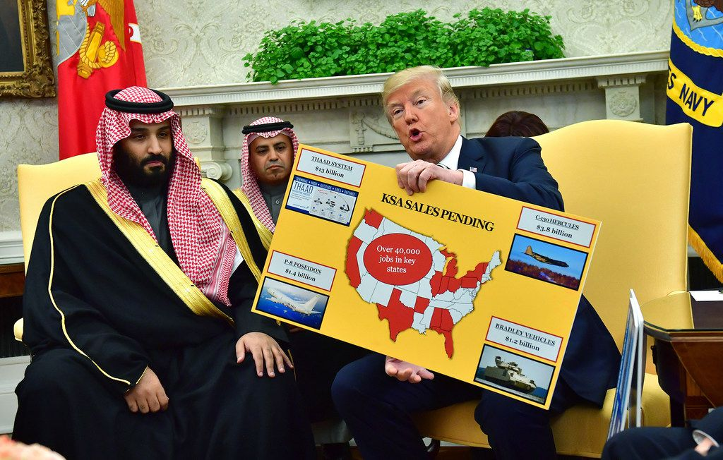 President Donald Trump holds up a chart of military hardware sales as he meets with Crown Prince Mohammed bin Salman of the Kingdom of Saudi Arabia in the Oval Office of the White House on March 20, 2018, in Washington, D.C.  (Kevin Dietsch-Pool/Getty Images/TNS) **FOR USE WITH THIS STORY ONLY**