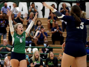 Northwest Eaton's Callie Humphrey (6) celebrates with teammates following a point during Tuesday's four-set win over Southlake Carroll. (Steve Hamm/Special Contributor)