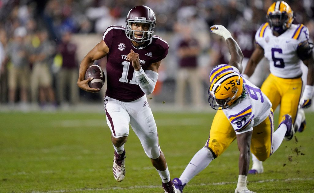 FILE - Texas A&M quarterback Kellen Mond (11) breaks away from LSU defensive end Glen Logan (97) during the first half of an NCAA college football game Saturday, Nov. 24, 2018, in College Station, Texas. (AP Photo/David J. Phillip)