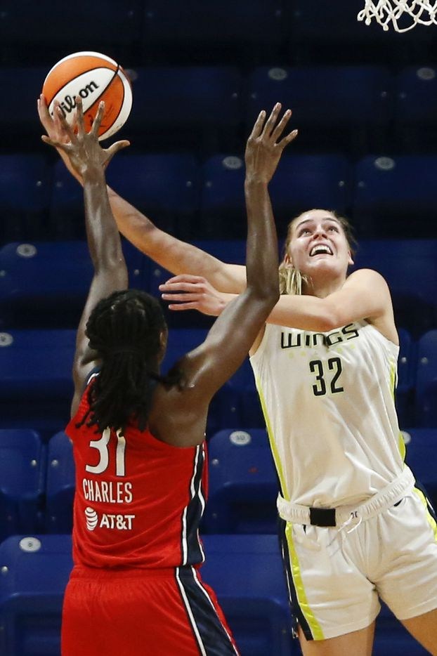 Dallas Wings center/forward Bella Alarie (32) attempts a layup in front of Washington Mystics center Tina Charles (31) during the first quarter at College Park Center on Saturday, June 26, 2021, in Arlington. (Elias Valverde II/The Dallas Morning News)