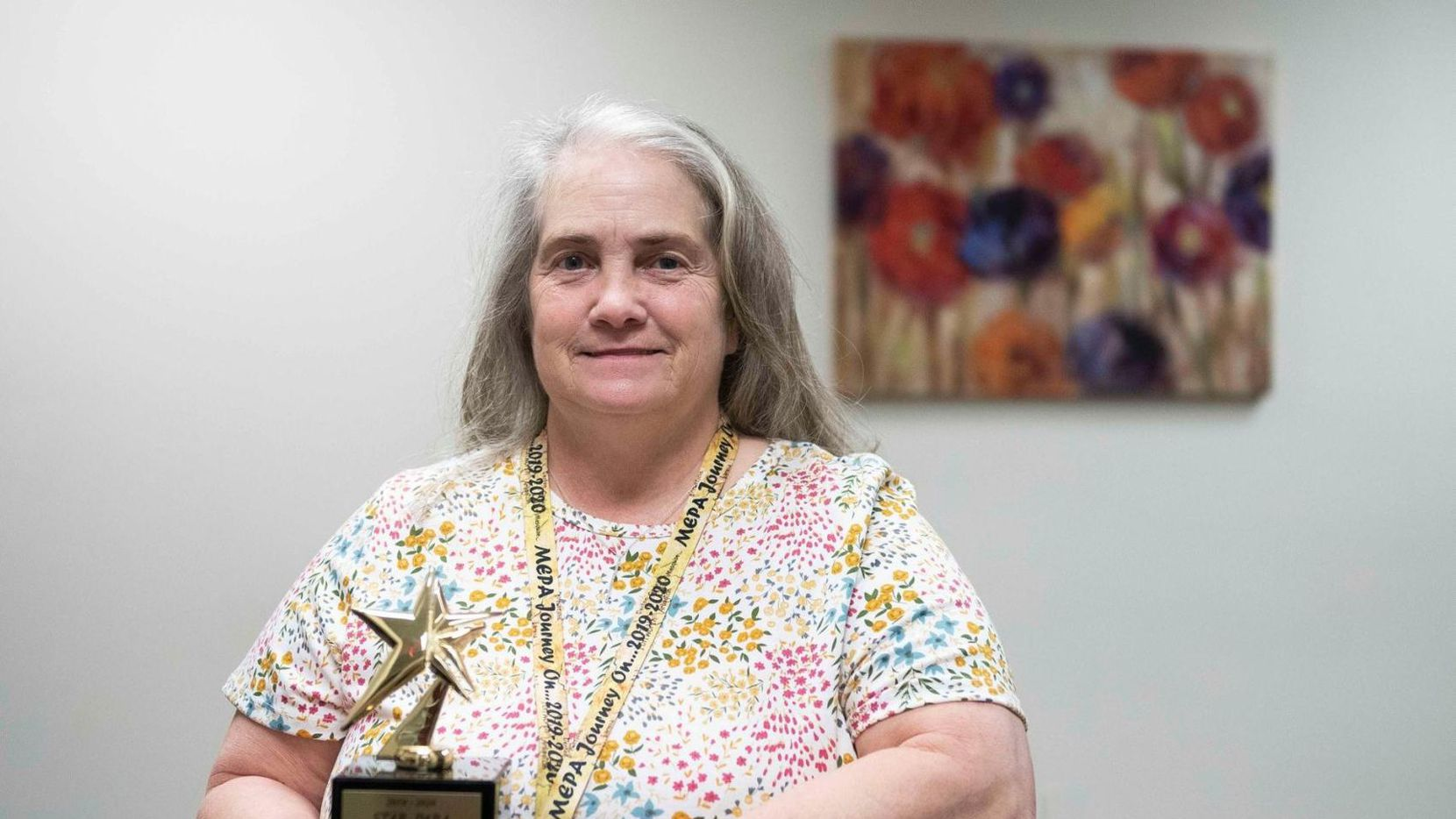 Yvonne Smeltze poses for a photo with the STAR Paraprofessional of the Year award. She won the award despite dealing with a house fire in 2019 that displaced her for half the year.