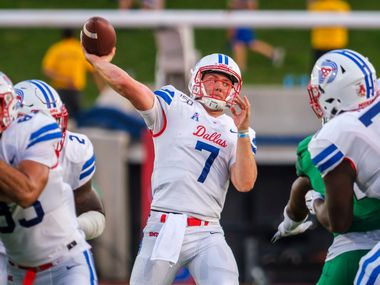 FILE - SMU quarterback Shane Buechele (7) throws a touchdown pass to wide receiver Reggie Roberson Jr. during the first half of a game against North Texas at Ford Stadium on Saturday, Sept. 7, 2019, in Dallas.
