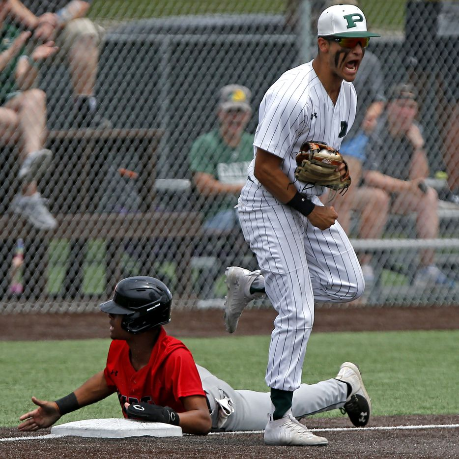 Prosper third baseman Gabriel Colina (13) reacts to picking off Martin center fielder Tristen Bittle (12) in the fifth inning as Prosper High School hosted Arlington Martin High School in a series final 6A Region I area round playoff game on Saturday afternoon, May 15, 2021. (Stewart F. House/Special Contributor)