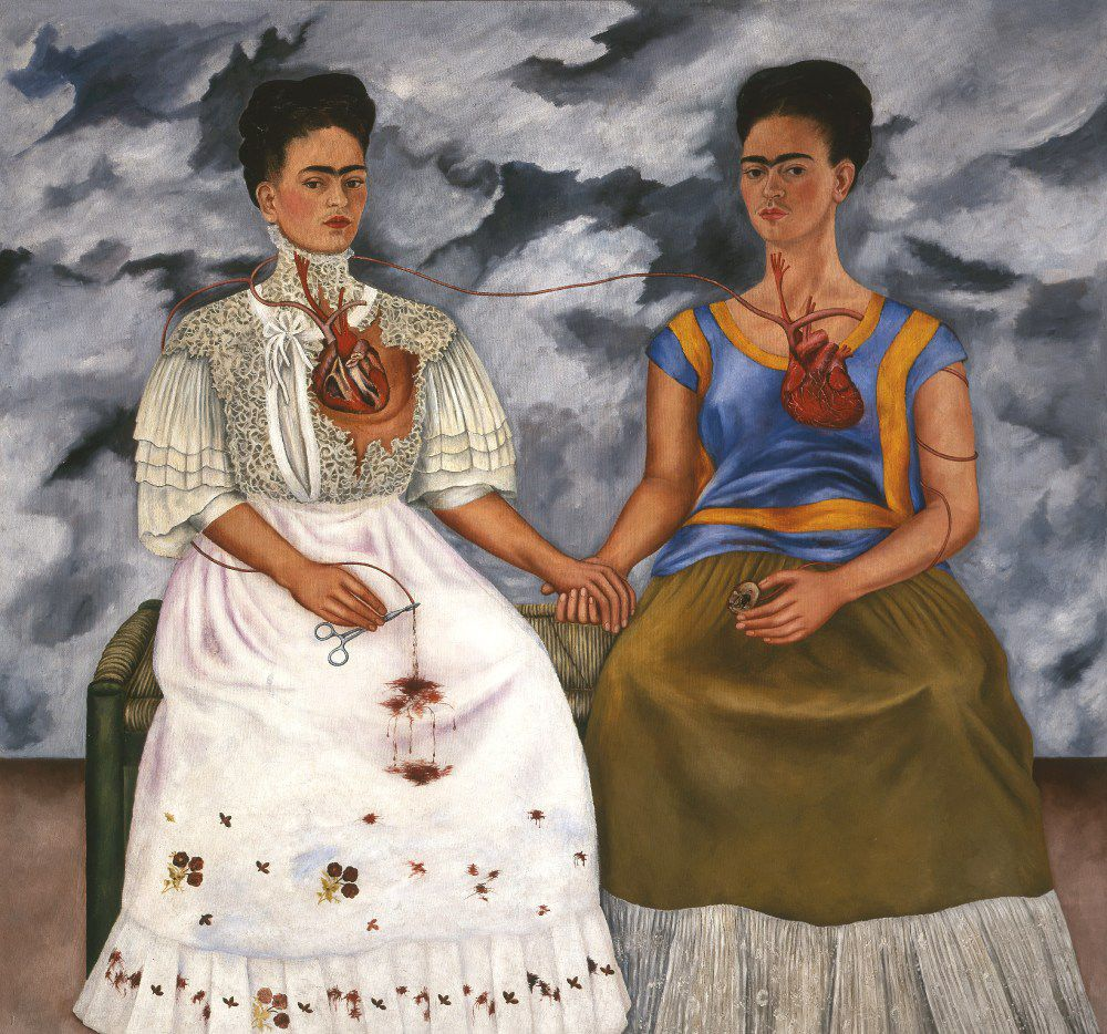 This painting is included in the new show at the Dallas Museum of Art. Here are the details: Frida Kahlo, The Two Fridas (Las dos Fridas), 1939 Oil on canvas Overall: 68 x 68 in. (173 x 173 cm) Mexico, INBA, collection Museo de Arte Moderno   2017 Banco de M xico Diego Rivera Frida Kahlo Museums Trust, Mexico, D.F. / Artists Rights Society (ARS), New York