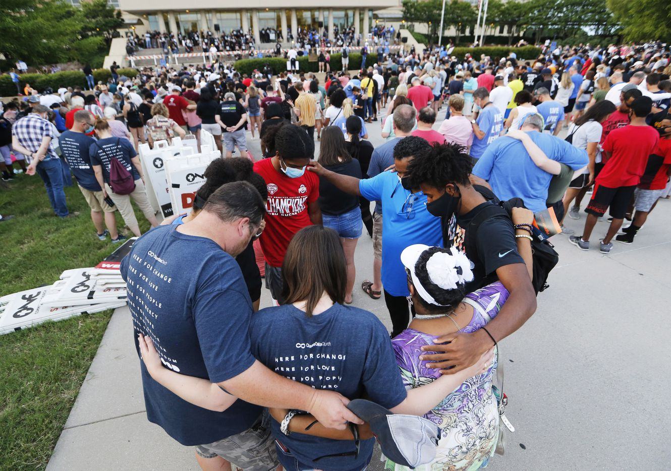 """People pray as groups or individually during """"A Gathering of Our Collin County Churches,"""" at the Collin County Courthouse in McKinney, Texas on Thursday, June 4, 2020. Churches in Collin county joined to spread a message of unity and love for justice and thoughts on racism."""
