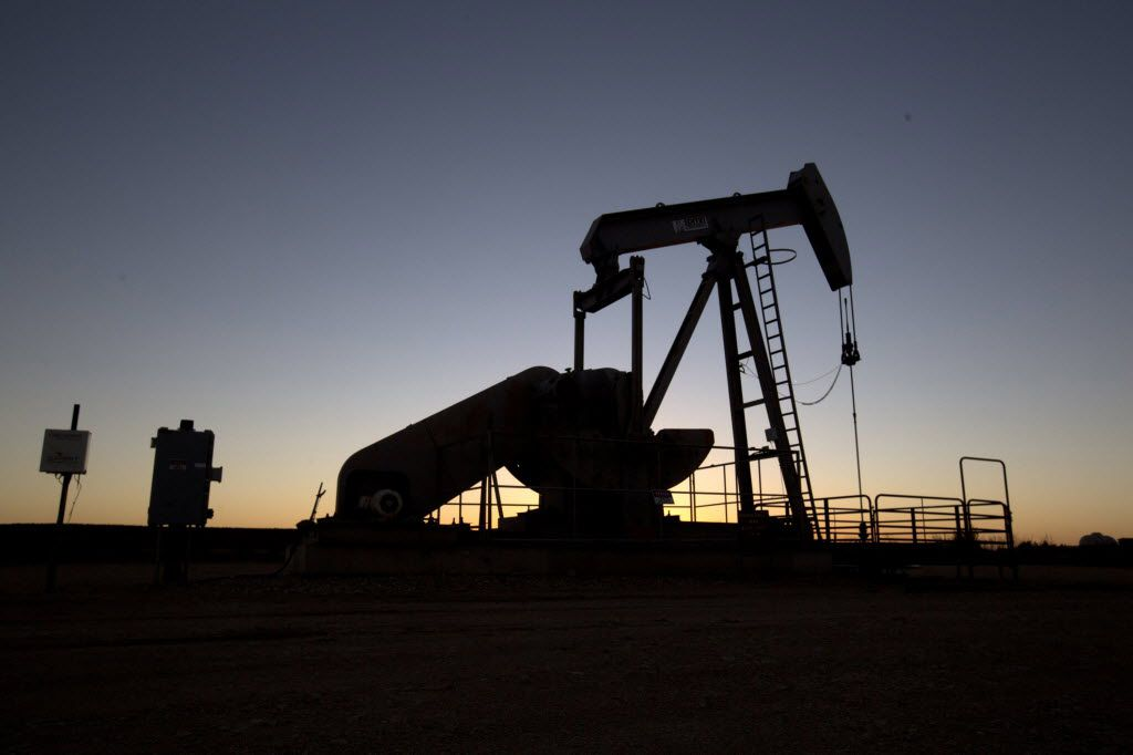 The price of oil is plummeting, the rigs are going silent and the immediate future doesn't look good for some. In Big Lake in the Permian Basin there is still some activity on Dec. 15, 2015. (Joyce Marshall/Fort Worth Star-Telegram)