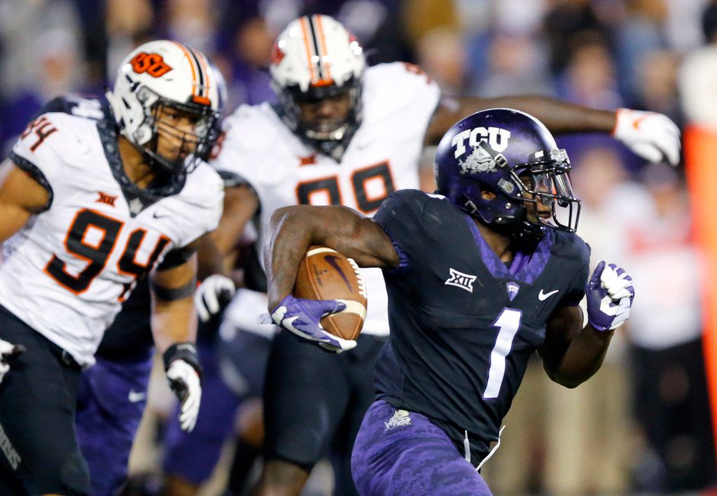 FILE - TCU Horned Frogs wide receiver Jalen Reagor (1) races around the end for a long third quarter touchdown run against Oklahoma State Cowboys defensive end Jordan Brailford (94) at Amon G. Carter Stadium in Fort Worth, Texas, Saturday, November 24, 2018. The Frogs hung onto win, 31-24. (Tom Fox/The Dallas Morning News)