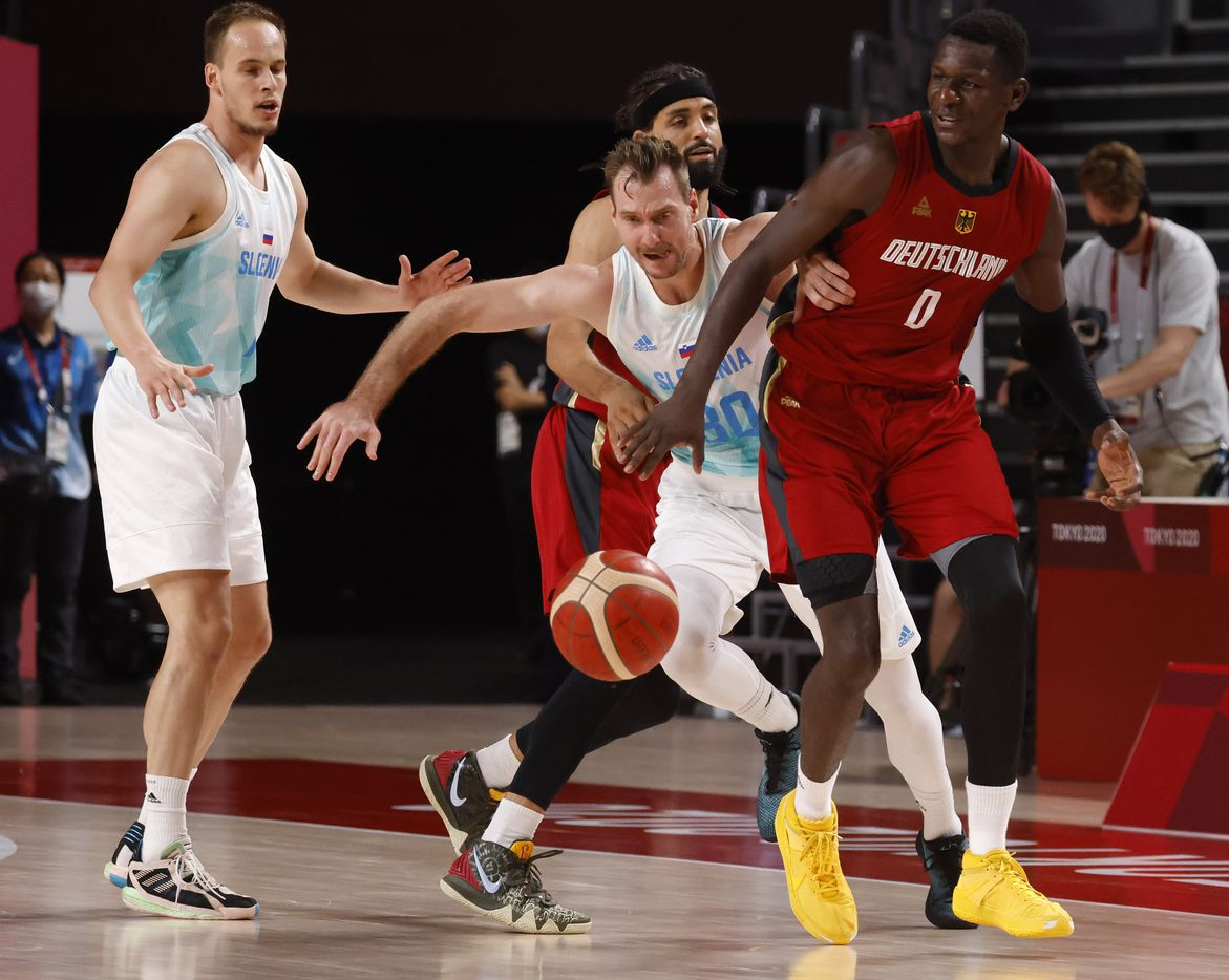 Slovenia's Zoran Dragic (30) knocks the ball out of the hands of Germany's Isaac Bonga (0) during the second half of play of a quarter final basketball game at the postponed 2020 Tokyo Olympics at Saitama Super Arena, on Tuesday, August 3, 2021, in Saitama, Japan. (Vernon Bryant/The Dallas Morning News)