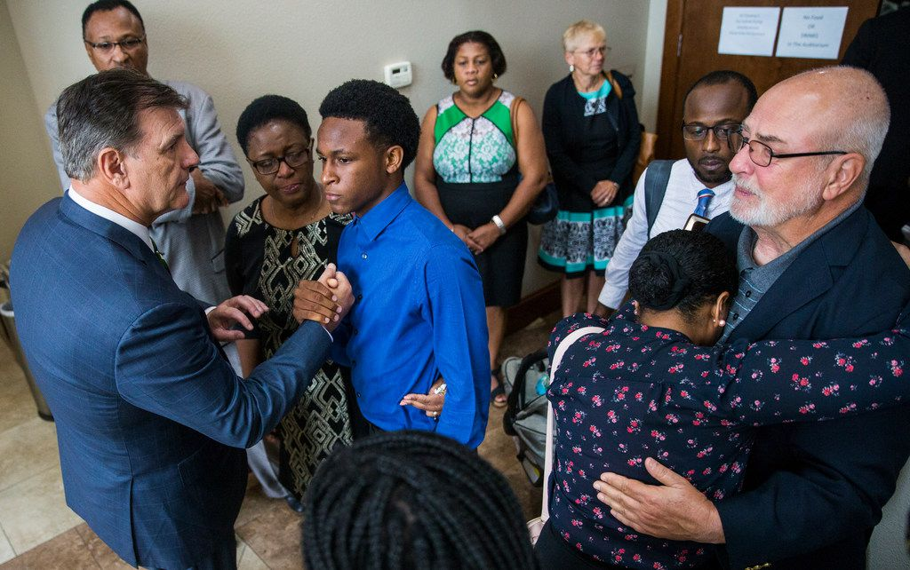 Brandt Jean greets Dallas Mayor Mike Rawlings as Grant's mother Allison Jean looks on following a prayer service for Botham Shem Jean on Sunday at Dallas West Church of Christ.