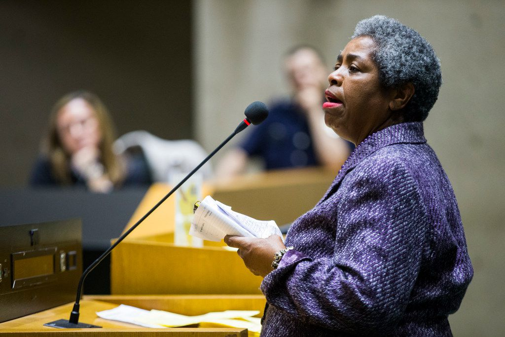 Sandra Crenshaw speaks in the public hearing forum at the Dallas Landmark Commission, before they voted to remove the Confederate War Memorial that currently stands in front of the downtown convention center on Monday, March 4, 2019 at Dallas City Hall. Images of the memorial are displayed behind Carter. (Ashley Landis/The Dallas Morning News)