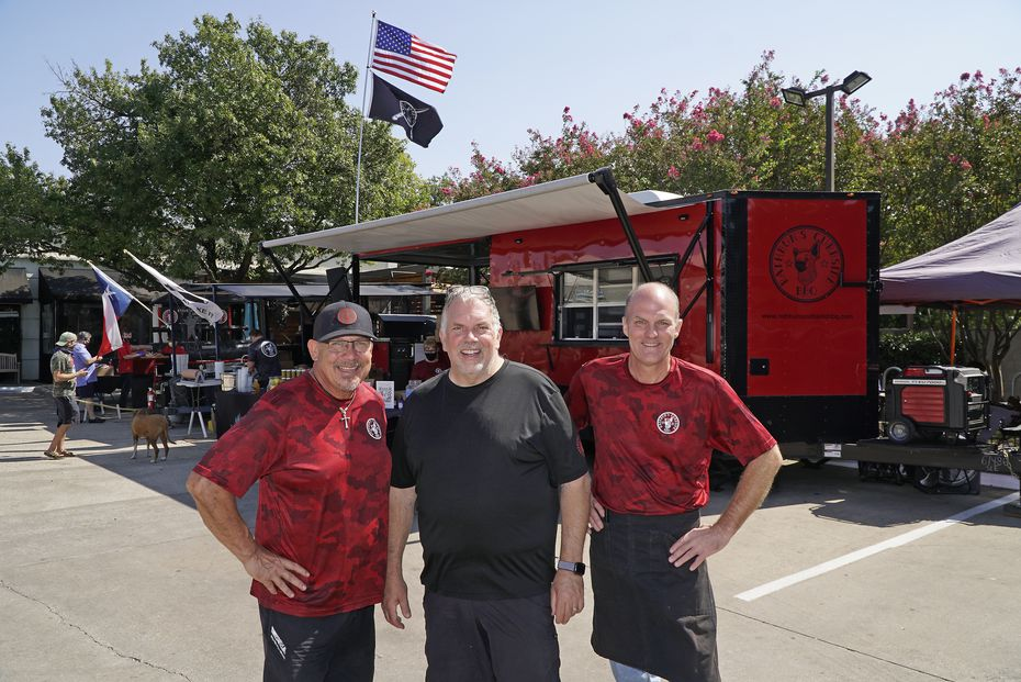 Rathbun's Curbside BBQ founders (from left) Mark Schorlemer, Kent Rathbun and Todd Boren park their two smokers and red concession trailer in a different spot in Dallas each weekend. Customers order online, then pay cash upon pickup.