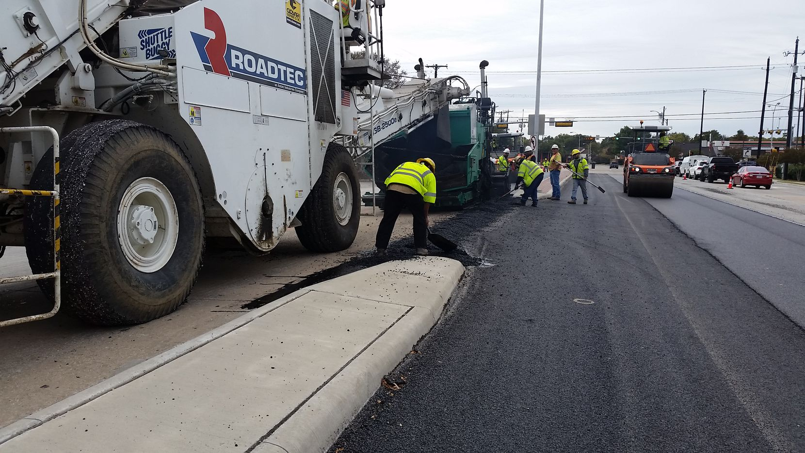 Crews in Plano are shown in June of 2021 working on one of several overlay pavement projects in the city.