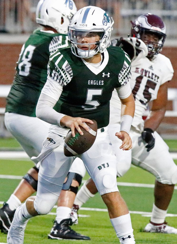 Prosper High School quarterback Berry Jackson (5) scrambles during the first half as Prosper High School hosted Rowlett High School in a non-district football game at Children's Health Stadium in Prosper on Friday, August 30, 2019. (Stewart F. House/Special Contributor)