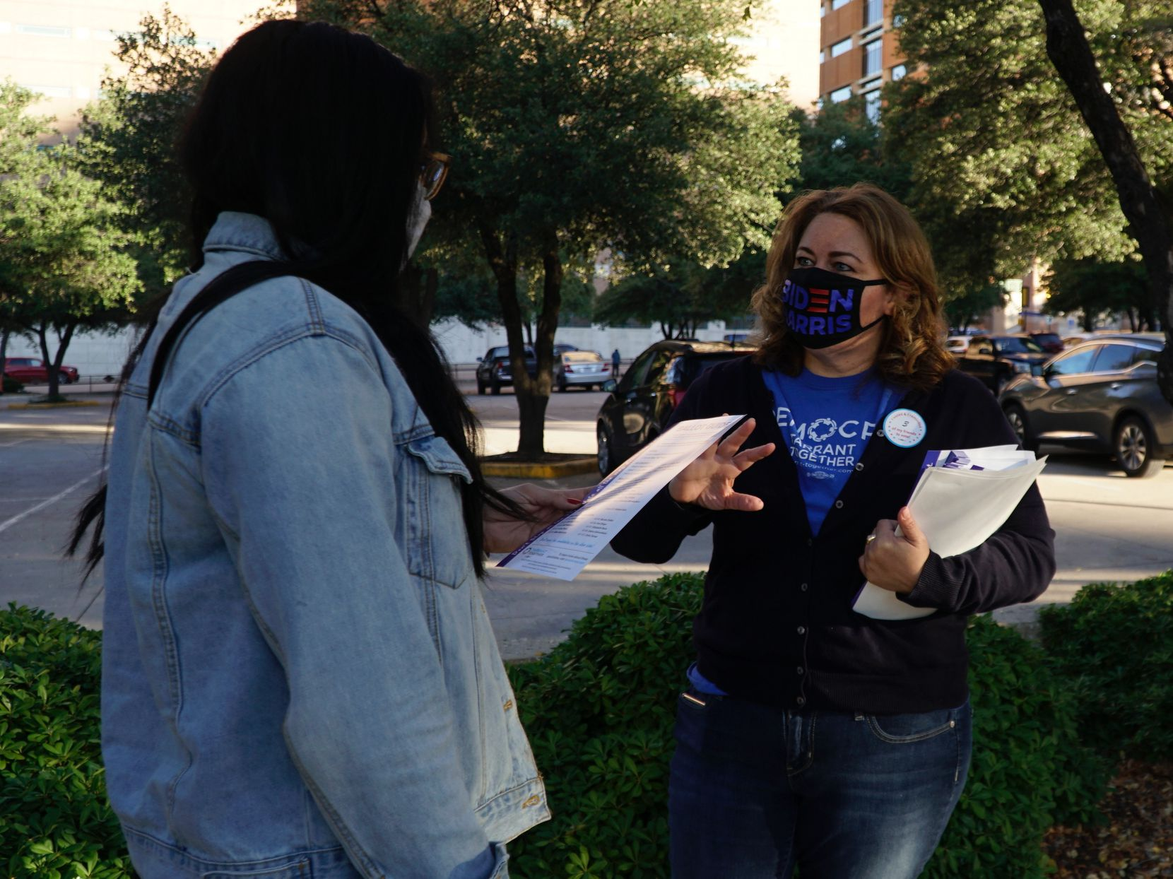 Biden volunteer Jana Lynne Sanchez handed out voting information outside the Tarrant County Plaza building in downtown Fort Worth on Nov. 3, 2020.