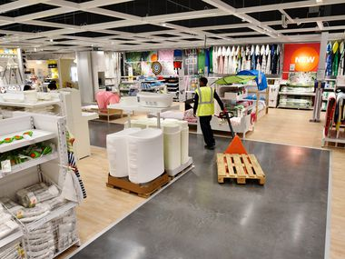 An employee pulls a pallet through the children's section inside the new IKEA furniture store in Grand Prairie.