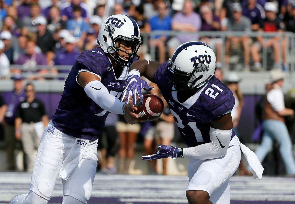 TCU quarterback Kenny Hill (7) hands the ball off to running back Kyle Hicks (21) in the first half of an NCAA college football game against Texas Tech on Saturday, Oct. 29, 2016, in Fort Worth, Texas. (AP Photo/Tony Gutierrez)