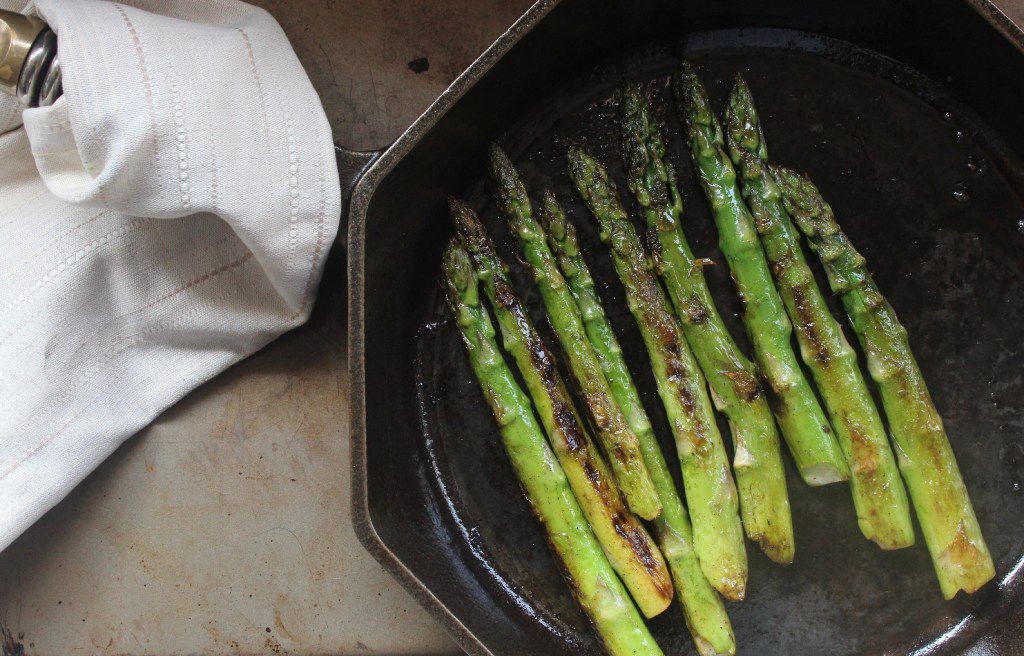 Coat asparagus evenly with butter by gently shaking the pan.