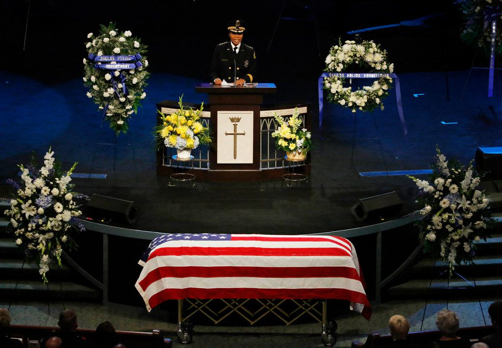 """Dallas Police Chief U. Renee Hall offers her condolences at the funeral service for Dallas Police Department Senior Cpl Earl James """"Jamie"""" Givens, held at Prestonwood Baptist Church in Plano, Texas on Thursday, July 26, 2018. (Louis DeLuca/The Dallas Morning News)"""