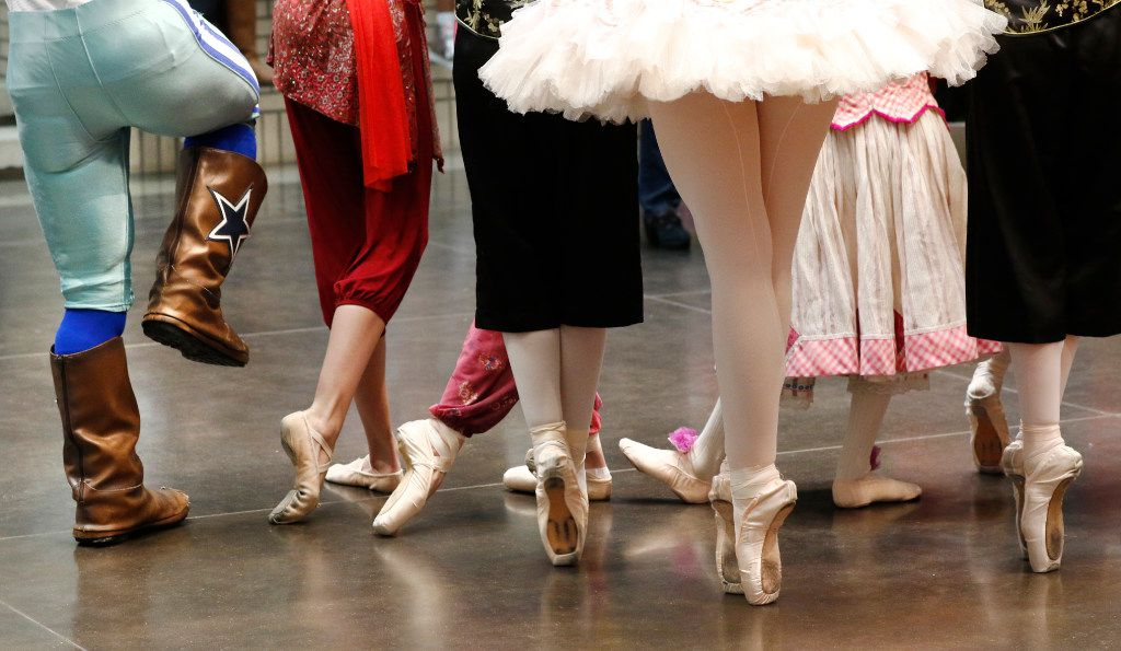 Dallas Cowboys mascot Rowdy, left, poses with dancers with the Texas Ballet Theater at NorthPark Center on Black Friday, November 25, 2016 in Dallas, Texas. (David Woo/The Dallas Morning News)
