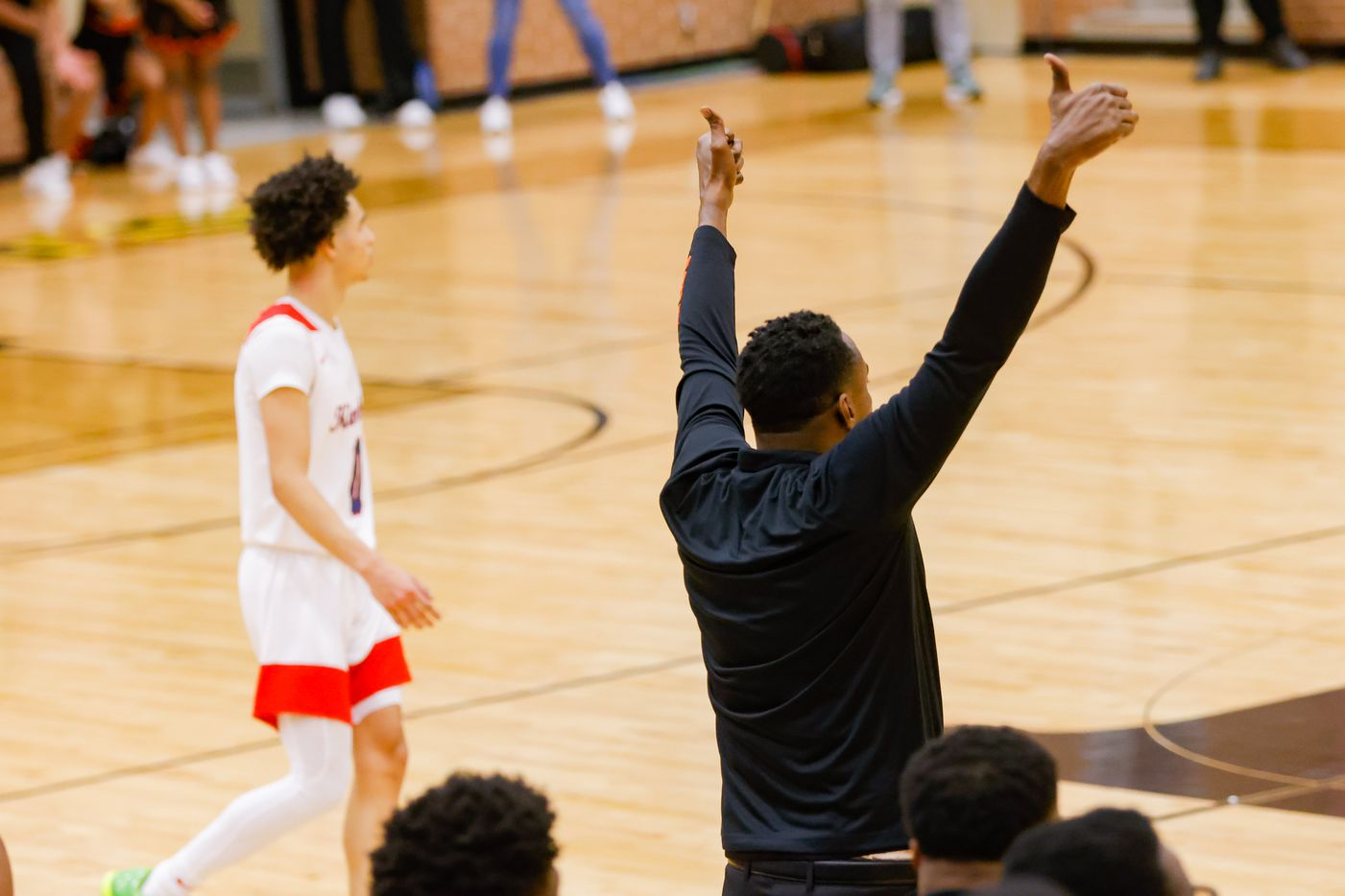 Lancaster's coach Ferrin Douglas celebrates his team catching up to Kimball before the end of the first half of a boys basketball UIL Class 5A Region II playoff game against Kimball in Forney on Friday, March 5, 2021. (Juan Figueroa/ The Dallas Morning News)