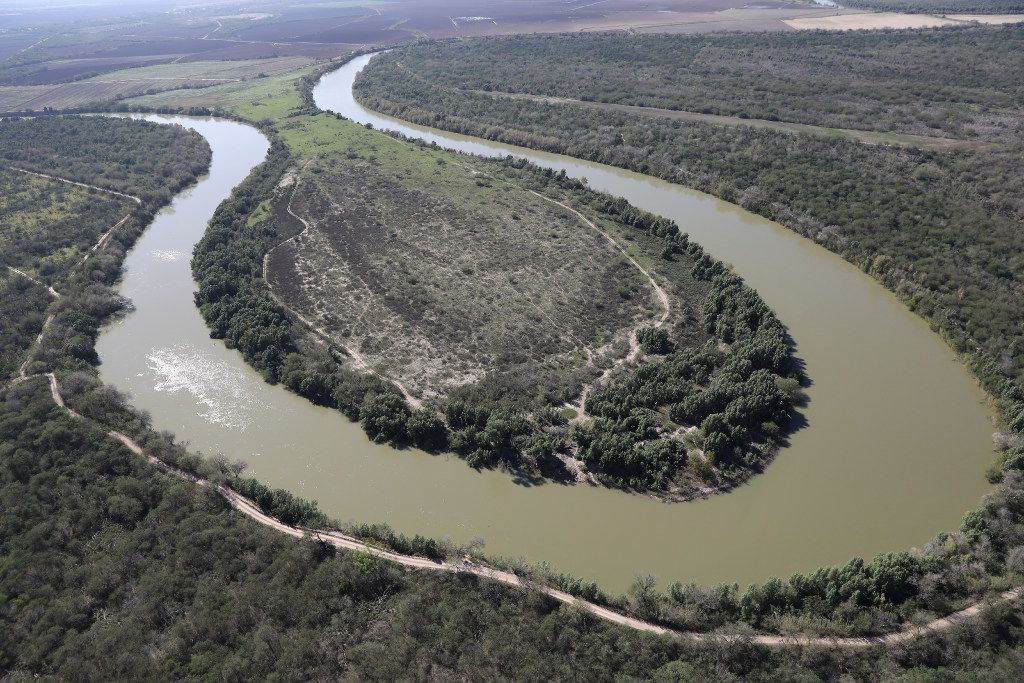 MCALLEN, TX - JANUARY 03:  The Rio Grande snakes along the U.S.-Mexico border on Jan. 3, 2017, near McAllen, Texas. Smugglers ferry thousands of immigrants across the river every year from Mexico into Texas. Hundreds of immigrants die annually while making the perilous journey into the United States.  (Photo by John Moore/Getty Images)