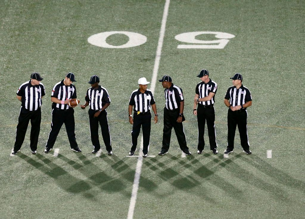 Seven referees prepare to officate the Irving-DeSoto high school football game in Irving, Texas, on October 19, 2017. (Michael Ainsworth/Special Contributor)