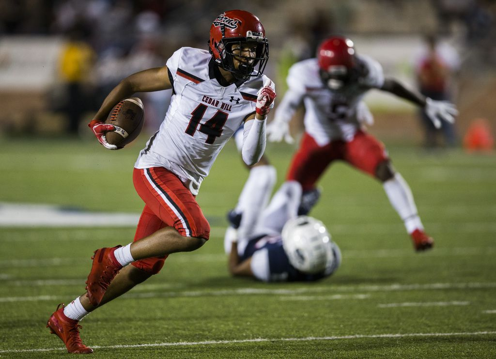 Cedar Hill wide receiver Anthony Thomas (14) runs the ball during the fourth quarter of a high school football game between Allen and Cedar Hill on Friday, August 30, 2019 at Eagle Stadium in Allen. (Ashley Landis/The Dallas Morning News)