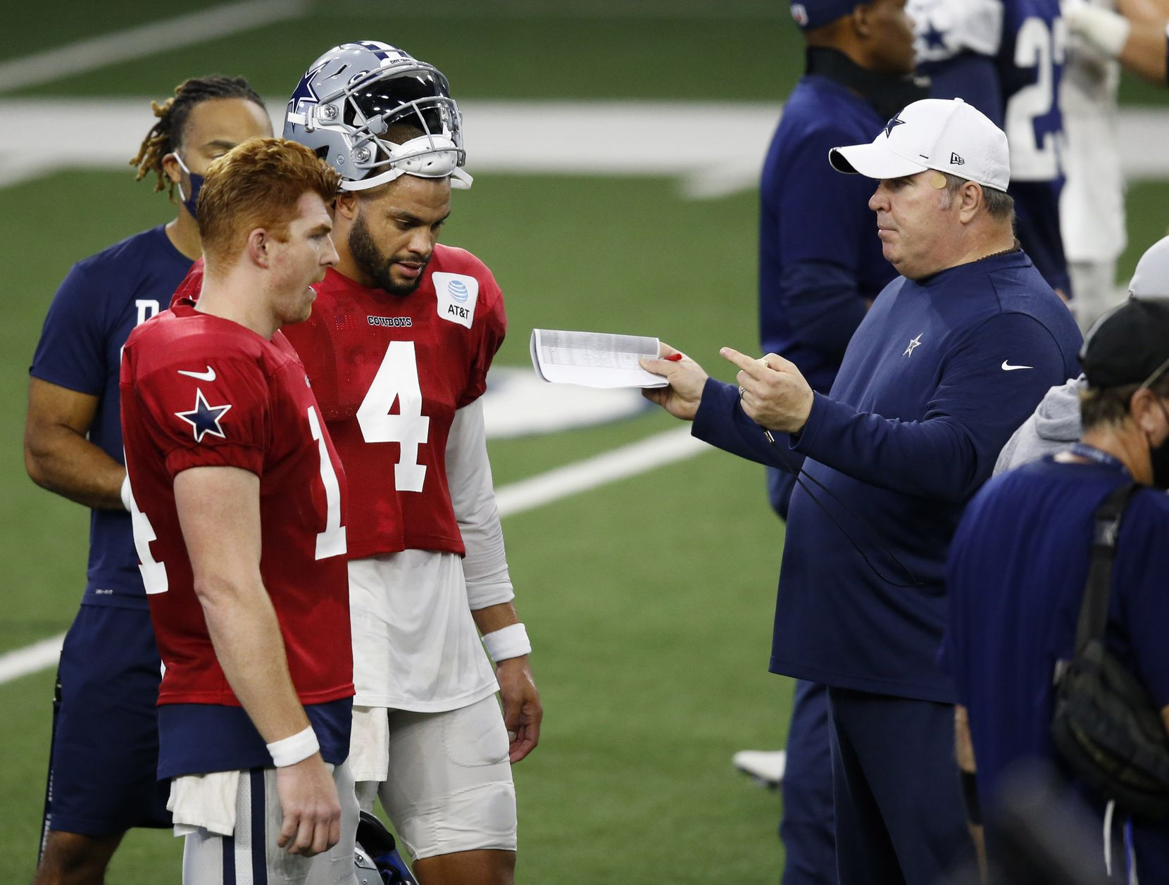 Dallas Cowboys head coach Mike McCarthy talks with Dallas Cowboys quarterback Andy Dalton (14) and Dallas Cowboys quarterback Dak Prescott (4) in practice during training camp at the Dallas Cowboys headquarters at The Star in Frisco, Texas on Friday, August 28, 2020. (Vernon Bryant/The Dallas Morning News)