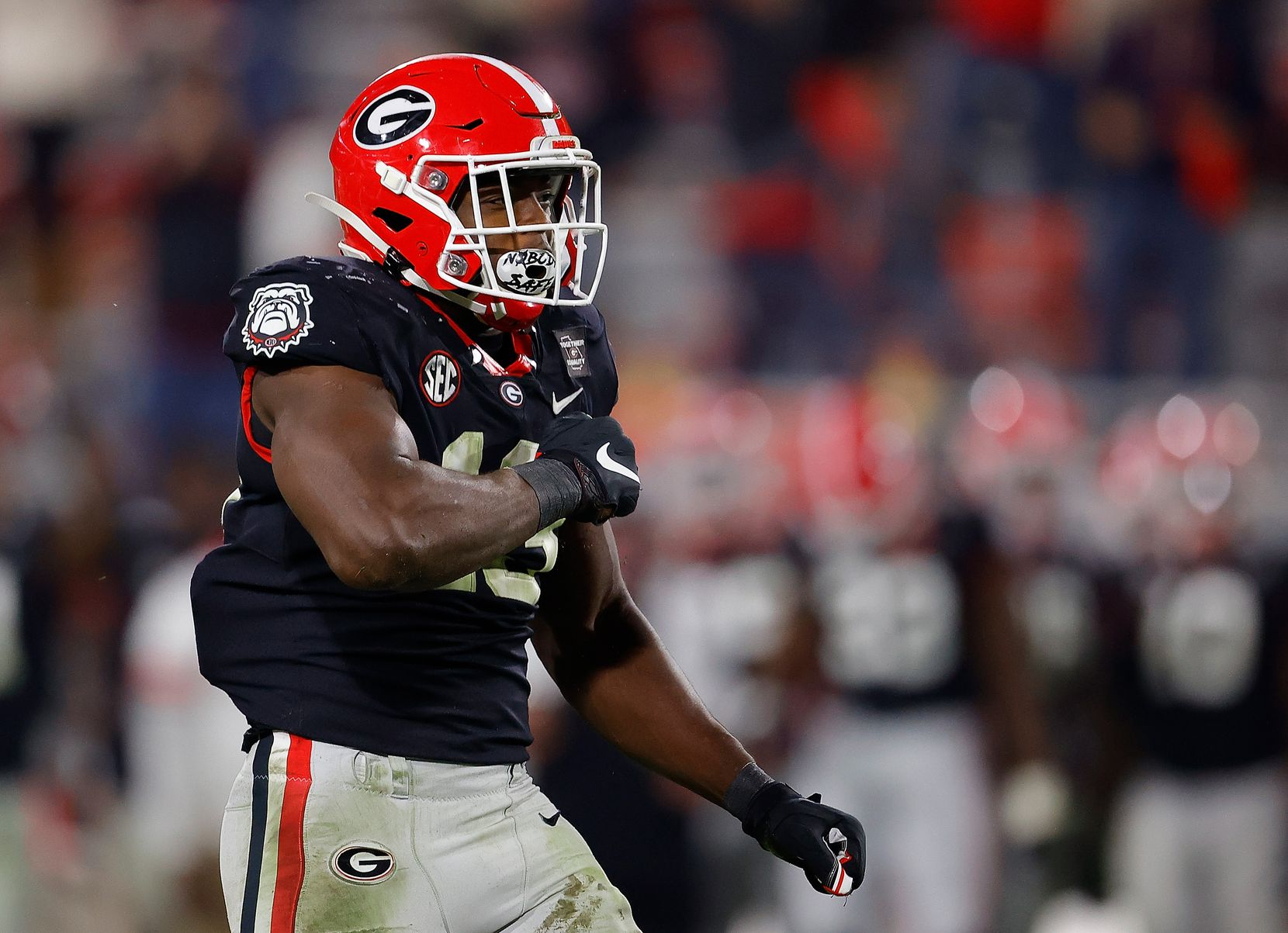 ATHENS, GEORGIA - NOVEMBER 21:  Azeez Ojulari #13 of the Georgia Bulldogs reacts after sacking Will Rogers #2 of the Mississippi State Bulldogs in the final minutes of the second half at Sanford Stadium on November 21, 2020 in Athens, Georgia. (Photo by Kevin C. Cox/Getty Images)