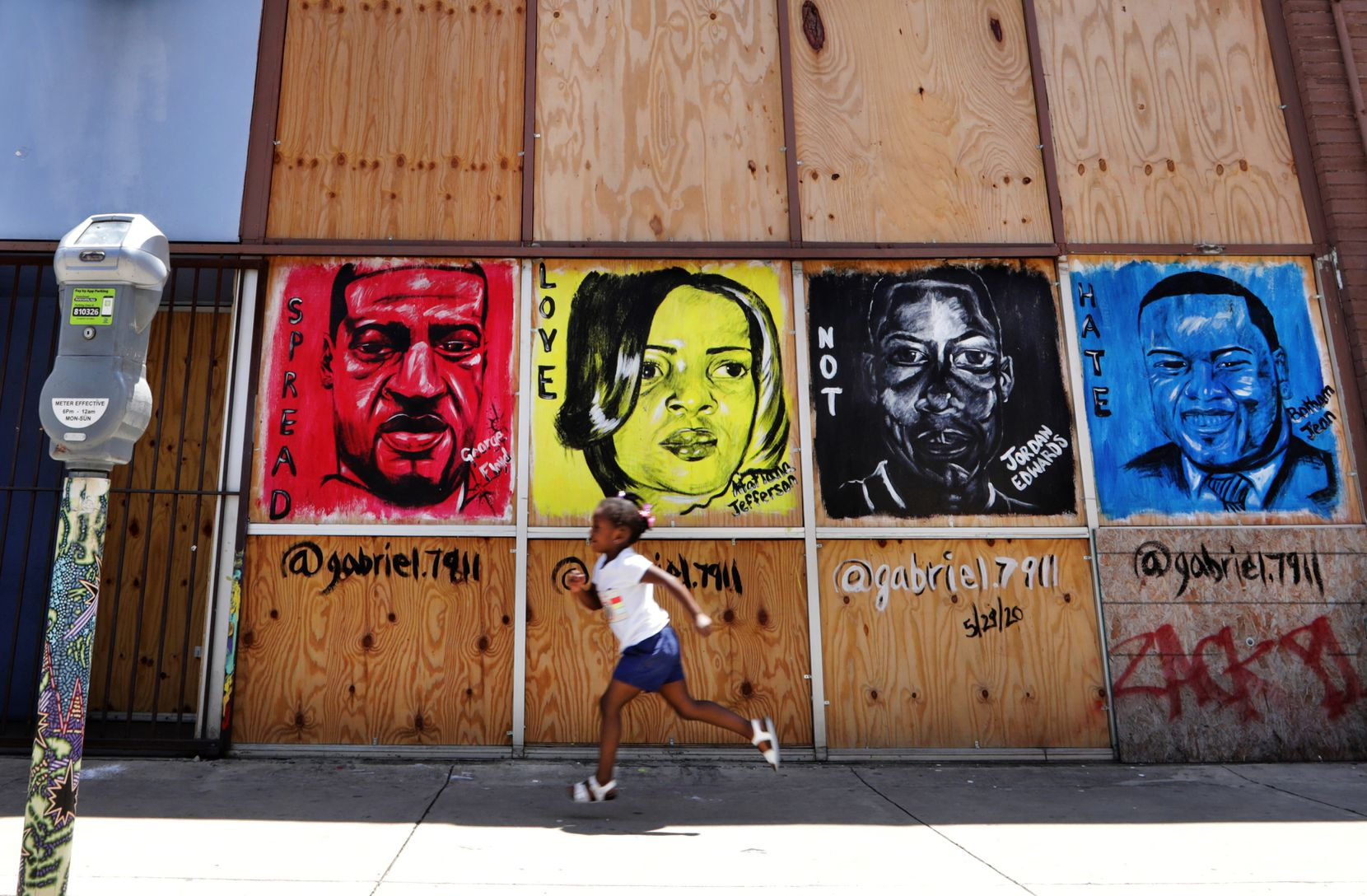 A mural painted in Deep Ellum days after George Floyd's death May 25 depicts, from left, Floyd, Atatiana Jefferson, Jordan Edwards and Botham Jean. Jefferson, Edwards and Jean were killed by North Texas police officers.