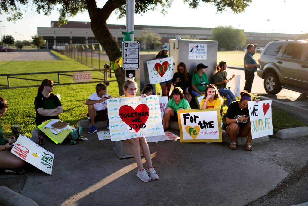 Santa Fe High School supporters gathered by the school Tuesday to wish student and staff well as they returned to classes for the first time since a student killed 10 people.