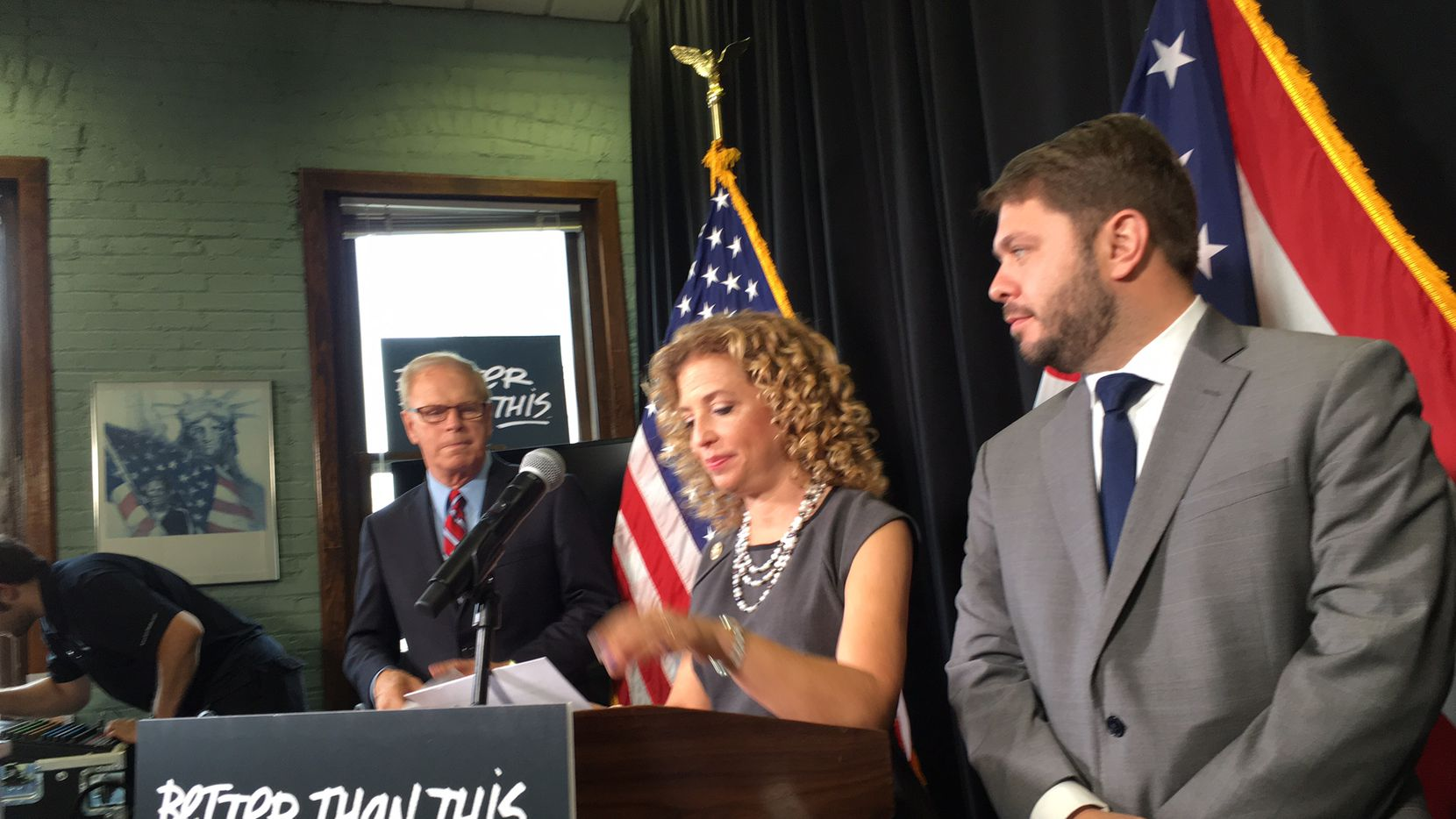 Democratic National Committee Chairwoman Debbie Wasserman Schultz (center)  bashes Donald Trump at a news conference near the Republican National Convention in Cleveland. She is joined by former Ohio Gov. Ted Strickland (left) and Rep. Ruben Gallego of Arizona.