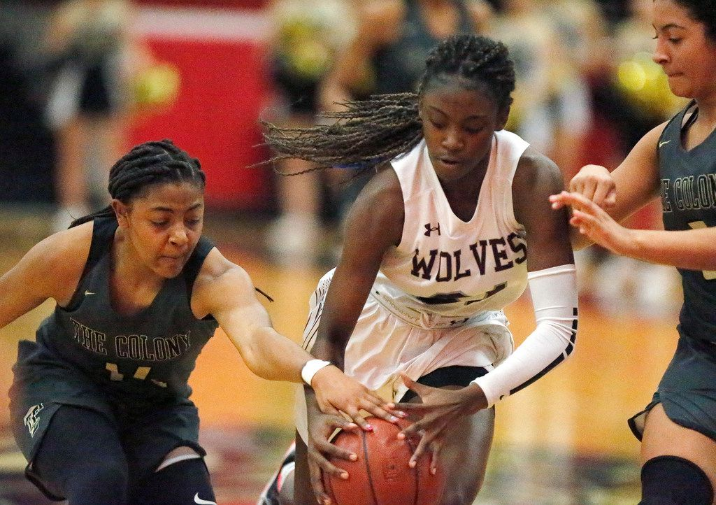 The Colony High School Tamia Jones (14) stops the dribble of Timberview High School guard Stephanie Mosley (21) while The Colony High School guard Kennedy Shaw (5) looks on during the first half as The Colony High School hosted Timberview High School in a Class 5A Region I quarterfinal girls basketball game at Colleyville Heritage High School on Monday night, February 24, 2020. (Stewart F. House/Special Contributor)
