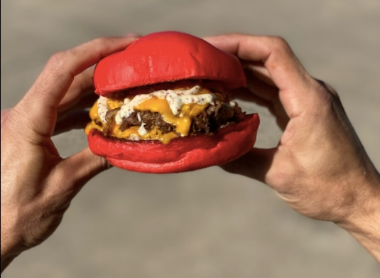 Wulf Burger prepares its specialty Wulf Red Bun with all-natural beet extract.