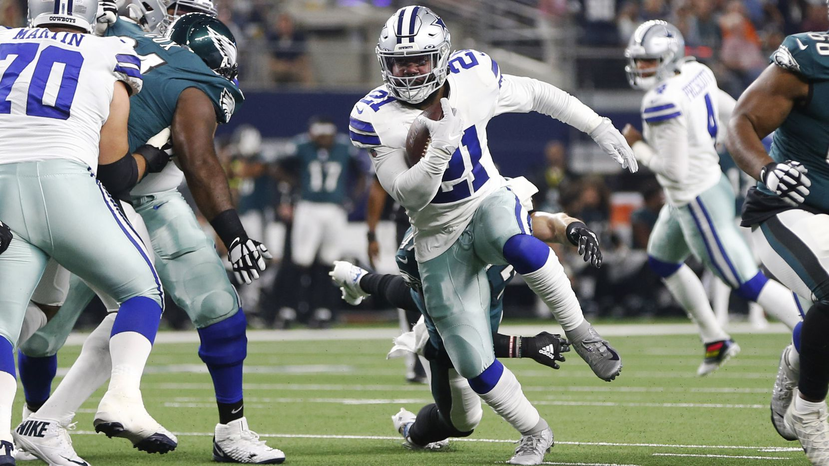 Cowboys running back Ezekiel Elliott (21) rushes upfield in the first half of a game against the Philadelphia Eagles at AT&T Stadium in Arlington on Sunday, Oct. 20, 2019. (Vernon Bryant/The Dallas Morning News)