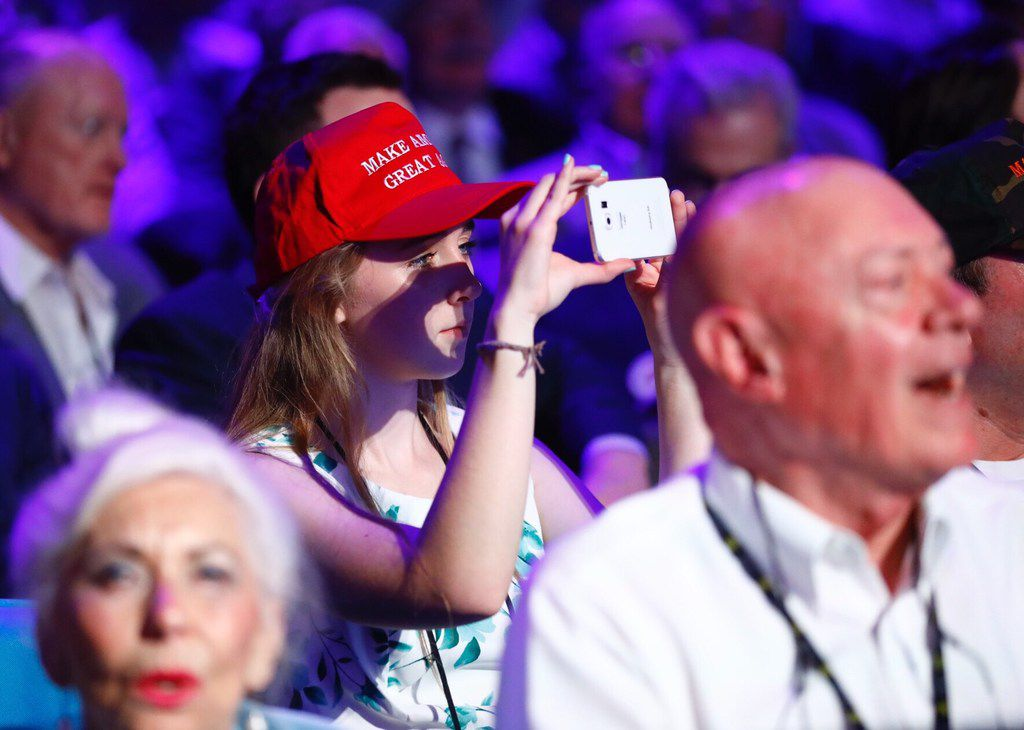 A NRA supporter photographs President Donald Trump as he speaks to the crowd assembled in the Kay Bailey Hutchison Convention Center for the NRA Annual Meeting in Dallas, Friday, May 4, 2018. . This is the second year as President that Trump has spoken to the gun rights group. (Tom Fox/The Dallas Morning News)