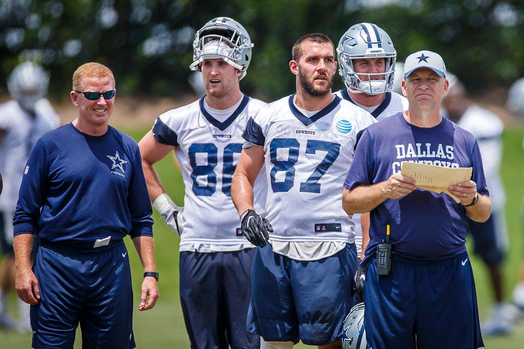 FILE - Dallas Cowboys head coach Jason Garrett (left) and offensive coordinator Scott Linehan watch the team with tight end Dalton Schultz (86) and tight end Geoff Swaim (87) during the team's minicamp at The Star on Wednesday, June 13, 2018, in Frisco. (Smiley N. Pool/The Dallas Morning News)