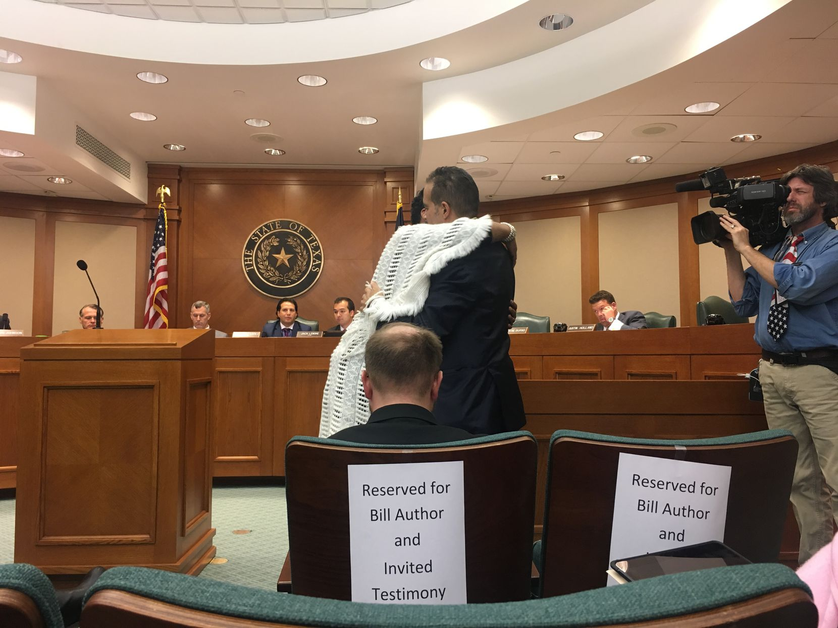 Geneva Reed-Veal, Sandra Bland's mother, and Rep. Garnet Coleman embrace during a hearing in the House Committee on Homeland Security and Public Safety on the Sandra Bland Act.