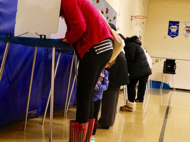Courtney Brown, left, of Richardson votes with her daughter Claire Brown, 3, at Yale Elementary School in Richardson on Tuesday, November 8, 2016.